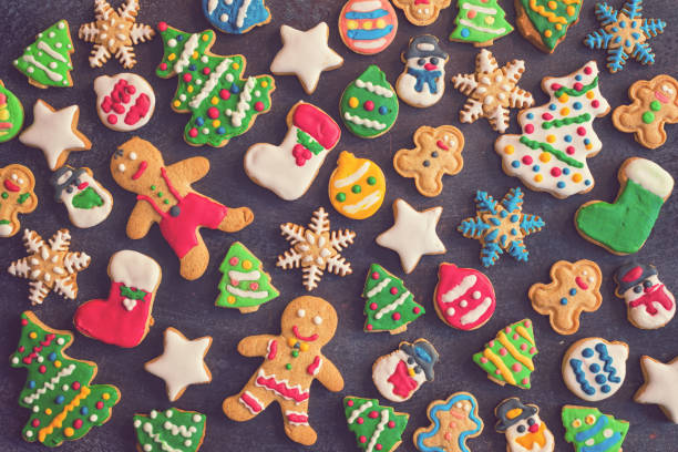 Christmas background with homemade gingerbread cookies, decoration and ingredients